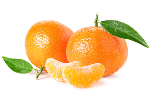 Tangerines or clementines with green leaf and slices isolated on white