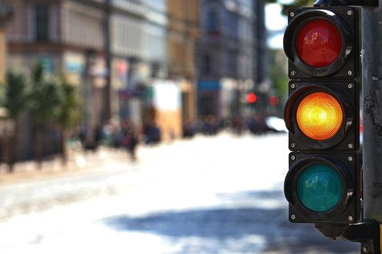 Traffic light  on the crossroad. Yellow light.