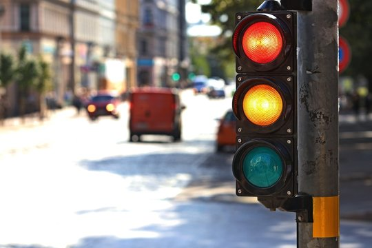 Traffic light  on the crossroad. Red and yellow light