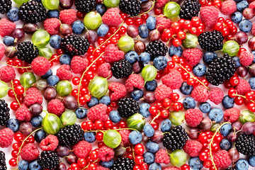 Wall Mural - heap of various berry fruits as textured background