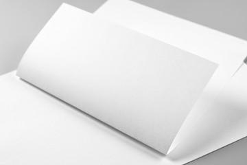 Blank Folded Letterhead or Flyer over Stack of Letterheads