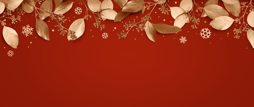 Red Christmas holiday background. Copy space for text with a garland of golden leaves and snowflakes. Design element for Christmas and New Year cards, banners. Top view. 3d illustration.