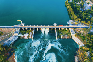 Aerial view of Dam at reservoir with flowing water, hydroelectricity power station, drone photo.