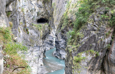 Winding Taroko Gorge River and Tunnel Entrance near Cliff - Taroko National Park, Taiwan