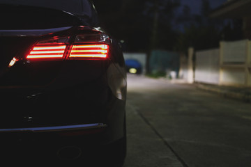 red taillight of modern sport car in the night street