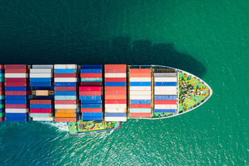 Aerial view cargo ship of business logistic transportation sea freight,Cargo ship, Cargo container in factory harbor at industrial estate for import export around in the world, Trade Port / Shipping Wall mural
