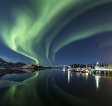 Hurricane of colors reflecting in the sea in Lofoten, Norway