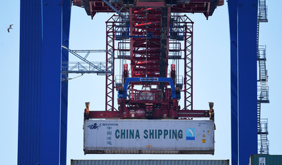 A container of China Shipping is loaded at a loading terminal in the port of Hamburg