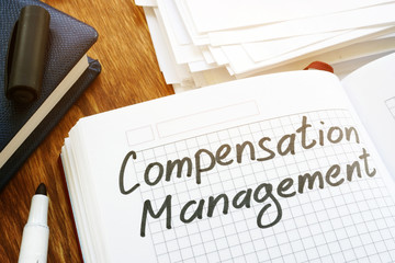 Compensation management concept. Book and papers in the office.