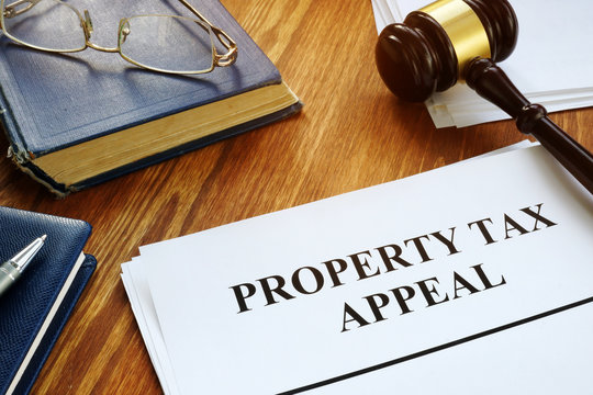 Property Tax Appeal documents and wooden gavel.