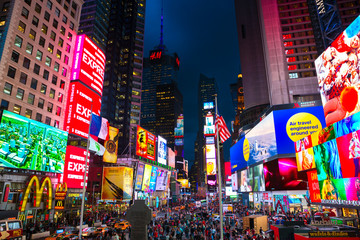 New York City, United States - November 3, 2017:  Night view of illuminated billboards on buldings facades at Times Square.