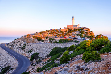 Beautiful white Lighthouse at Cape Formentor in the Coast of North Mallorca, Spain Balearic Islands. Artistic sunrise and dusk landascape.