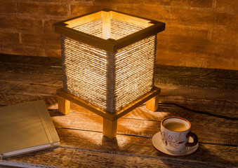 cup of coffee, notebook and vintage table lamp. Time for relax.