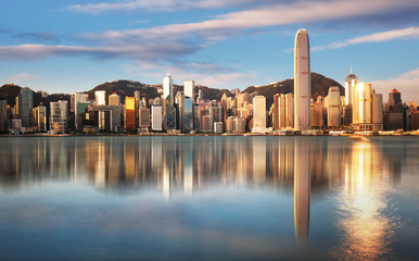 Hong Kong at sunrise with reflection, Financial downtow with skyscrapers