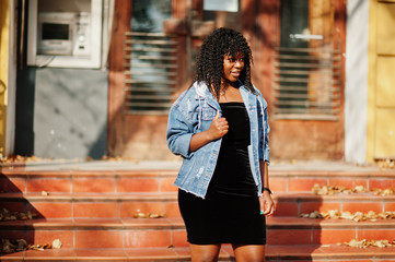 Stylish trendy afro france curly woman posed at autumn day in jeans jacket. Black african female...
