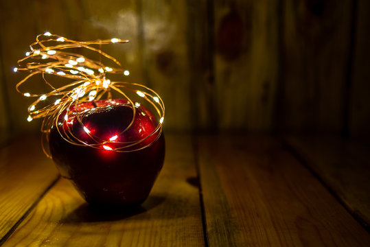 Red Apple on wood, with warm light, Good for christmas