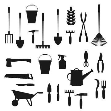 Garden tools. Shovel, rake, wheelbarrow, spade
