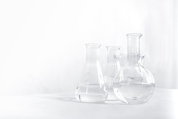 Science laboratory chemical beaker, Erlenmeyer and round flask lab glassware equipment. Research and development concept.
