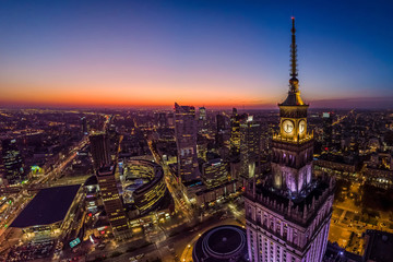 Warsaw city center and Warsaw skyscrapers at dusk aerial view