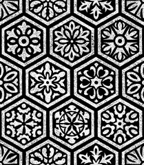 Seamless ornament in patchwork style. Set of hand-drawn hexagons. Black and white print for bohemian style textiles. Grunge texture. Vector illustration.