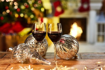 Christmas still life with glasses of red wine
