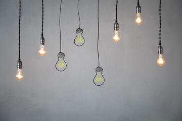 Idea concept - light bulbs against grey background