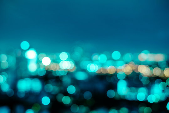 Abstract neo mint city night light blur bokeh. Vintage tone defocused background.