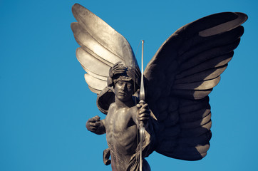 Statue of Anteros - mistakenly known as Eros - a top the Shaftesbury Memorial Fountain erected 1892 in Piccadilly Circus, London