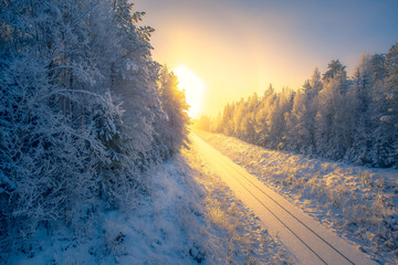 Snowy winter railroad view. First snow sunset landscape. Photo from Sotkamo, Finland.