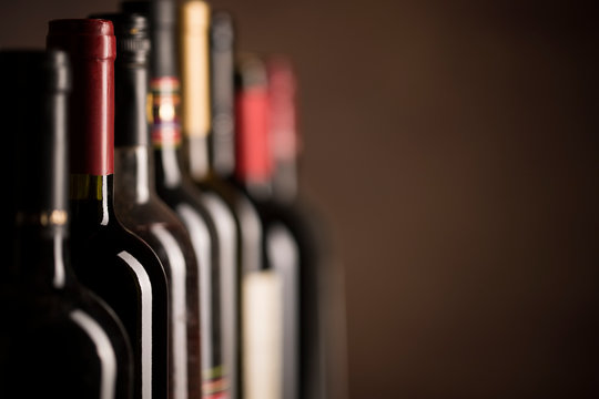 Wine bottles collection on a dark background