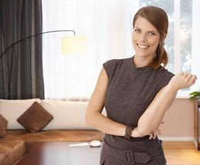 Happy elegant woman at home