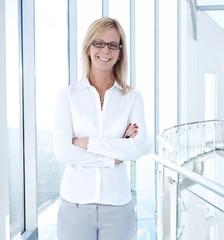 Happy businesswoman in glasses
