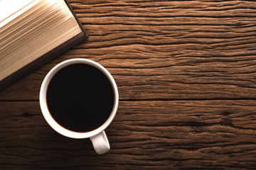 Coffee cups and coffee beans on the old kitchen table Top view with copyspace for your messages.