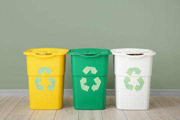 Containers for garbage near color wall. Recycling concept