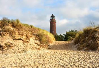 beautiful view over the sand dunes to the Lighthouse at the Darß peninsula near the village Prerow in Germany