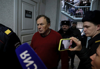 Russian historian Sokolov is escorted before a court hearing in Saint Petersburg