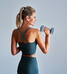 Adult woman working out with dumbells