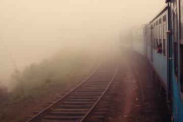 Tuinposter Spoorlijn Train in misty foggy mountain railroad, beautiful mountains landscape. Are Lanka, way to Ella