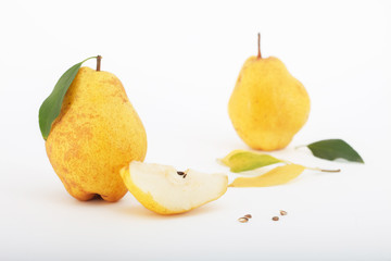 Delicious and juicy Bartlett pears with leaves isolated on white background. Healthy autumn fruit.