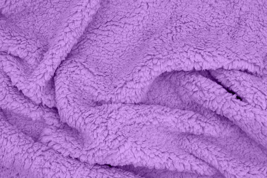 Purple sherpa textured plush fabric material background