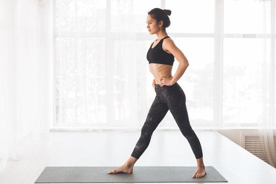 Yoga training. Slim preparing for doing stretching exercise