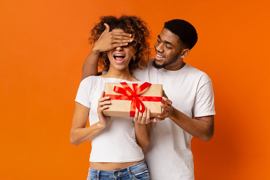 Loving black guy surprising his girlfriend with gift