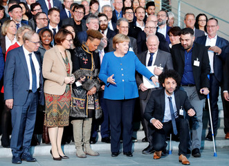 German Chancellor Angela Merkel poses for a group photo with participants of the national integration prize in Berlin