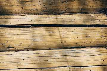 Texture of a wooden wall made of old logs-background image