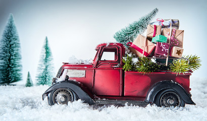 Vintage red truck delivering Christmas gifts