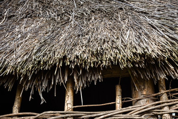 An old hut made of dry twigs.