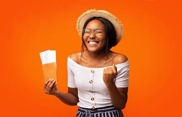 Happy Afro Girl Holding Tickets And Passport Standing, Studio Shot