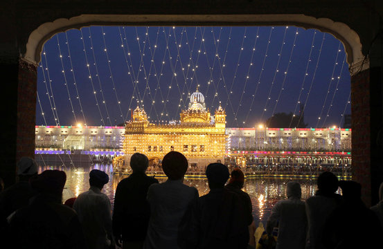 The Golden Temple is seen illuminated as Sikh devotees arrive on the eve of the 550th birth anniversary of Guru Nanak Dev, the first Sikh Guru and founder of Sikh faith, in Amritsar