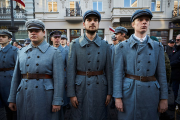 People take part in a parade marking the National Independence Day in Lodz