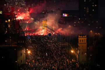 People burn flares during a march marking the National Independence Day in Warsaw